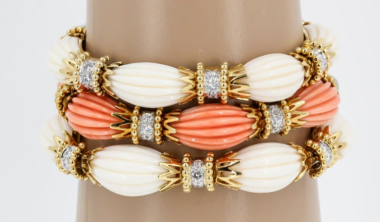 Impressive trio of diamond and coral bracelets set in 18K gold & platinum, by Van Cleef & Arpels, circa 1960s-70s. Very rare to find one in good condition, let alone three.  The white and salmon pink coral compliment eachother wonderfully. They