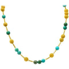 Van Cleef & Arpels Turquoise 18 Karat Gold Long Bead Rolo Station Necklace