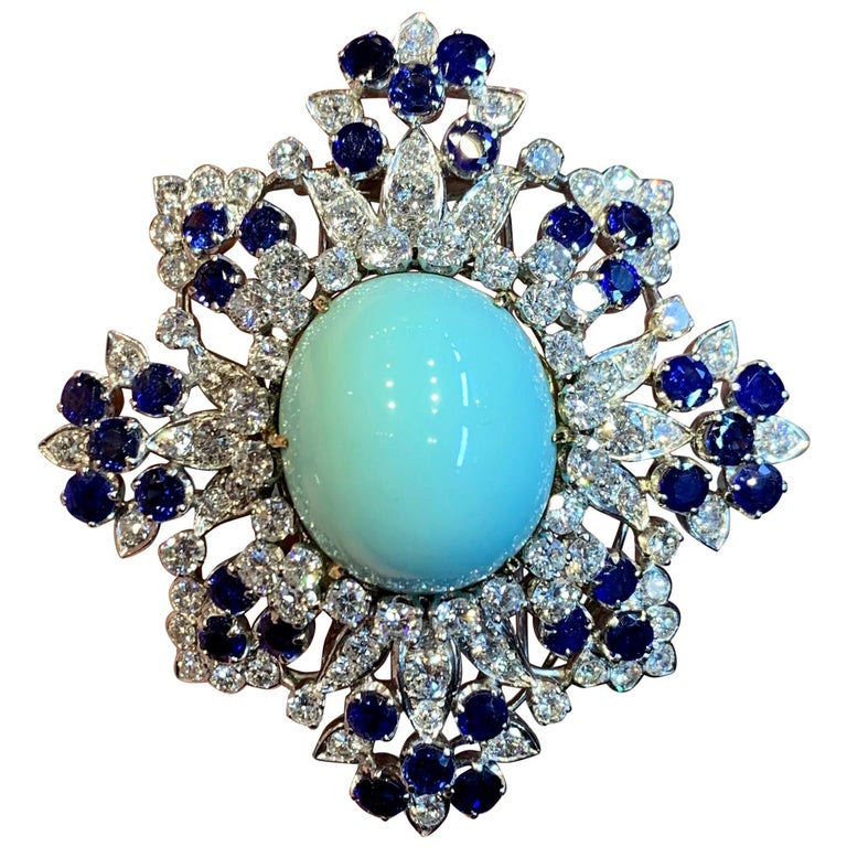 Van Cleef and Arpels Turquoise Sapphire and Diamond Brooch Pendant  Diamonds weighing a total of approximately 7.50 carats  Dimensions 2½ x 2¼ inches  yellow and white gold  Signed and numbered
