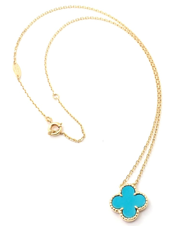 18k Yellow Gold Vintage Alhambra Turquoise Pendant Necklace by Van Cleef & Arpels.  With one 15mm motif of turquoise alhambra stone. This necklace comes with service paper from Van Cleef & Arpels store. Details:  Length: 16.5