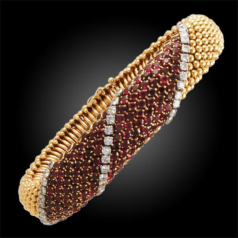A sublime set of 18k gold diamond and ruby bracelets, signed Van Cleef & Arpels. Length approx. 6 3/4 inch and 6 1/2 inch  with French assay marks
