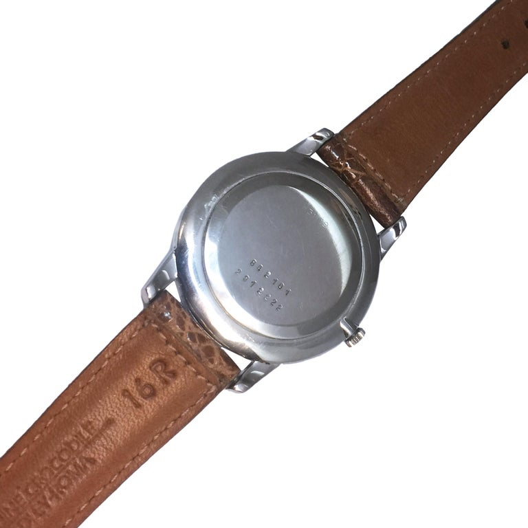 Van Cleef & Arpels Universal Geneve Wood Dial Steel Mechanical Wristwatch In Excellent Condition For Sale In Chicago, IL