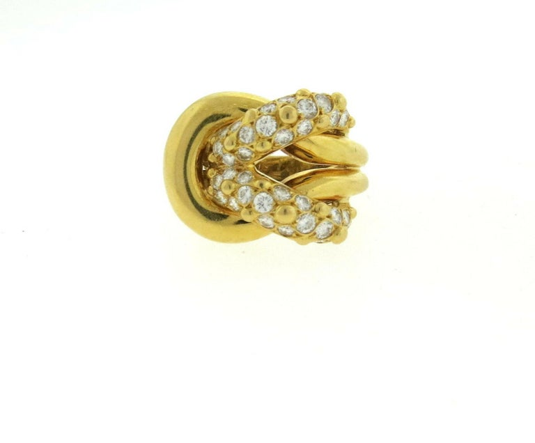 An 18k yellow gold ring set with approximately 1.20ctw of FG/VVS diamonds. Crafted by Van Cleef & Arpels. Measurements -  ring is a size 6, ring top is 19mm x 23mm. Marked - Van Cleef & Arpels, 750, 72, 122245. Weight-13.5 grams.