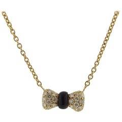 Van Cleef & Arpels VCA Gold Diamond Onyx Bow Pendant Necklace