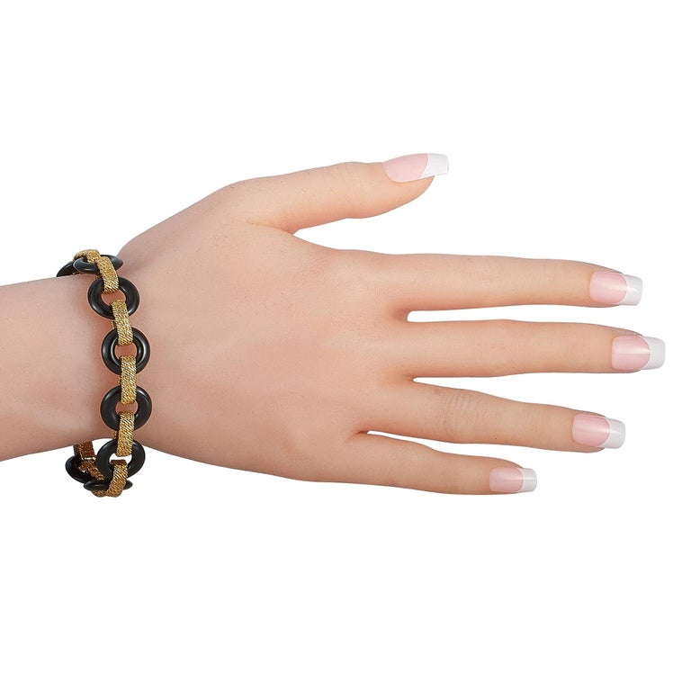"""This vintage Van Cleef & Arpels bracelet is made out of 18K yellow gold and onyx and weighs 43.4 grams. It measures 7.50"""" in length and features a fold over clasp.  The bracelet is offered in estate condition and includes a gift pouch."""