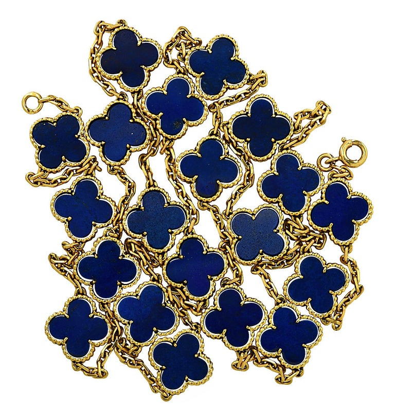 From the House of Van Cleef & Arpels, this exquisite Vintage Alhambra long necklace, 20 motifs, finely handmade in 18 Karat yellow gold, features an asymmetrical design inspired by the clover leaf. Twenty clover motifs embellished with blue lapis,