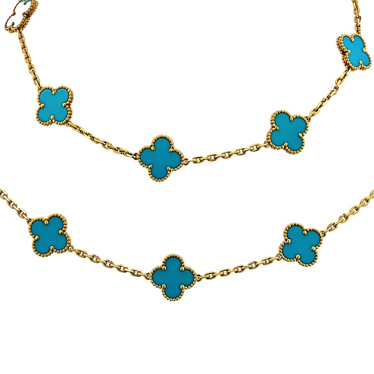 From the House of Van Cleef & Arpels, this exquisite Vintage Alhambra long necklace, 20 motifs, finely handmade in 18 Karat yellow gold, features an asymmetrical design inspired by the clover leaf. Twenty clover motifs embellished with turquoise,