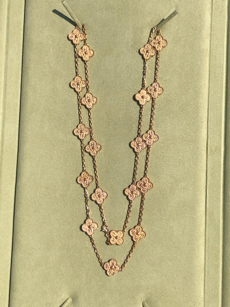 Authentic Van Cleef & Arpels 18 karat yellow gold long necklace featuring 20 clover leaf-inspired motifs. The necklace comes with original Van Cleef & Arpels box and authentic papers.   Retail Price: £13700  WEIGHT Approx 75.5g  METAL TYPE  18K ROSE