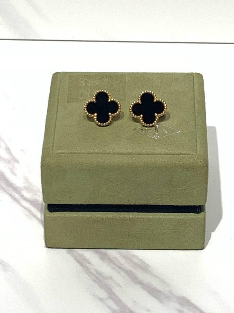 These classic earrings from the Vintage Alhambra collection by Van Cleef & Arpels feature black onyx inlays set in 18k yellow gold. An iconic and festive design inspired by the symbol of luck.   The earrings come in a VCA box.   STONES Onyx  METAL