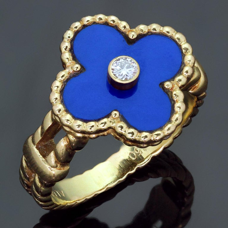 This fabulous Van Cleef & Arpels ring from the iconic Vintage Alhambra collection features the lucky clover design crafted in 18k yellow gold and bezel-set brilliant-cut round diamond of an estimated 0.06 carats surrounded by blue lapis lazuli