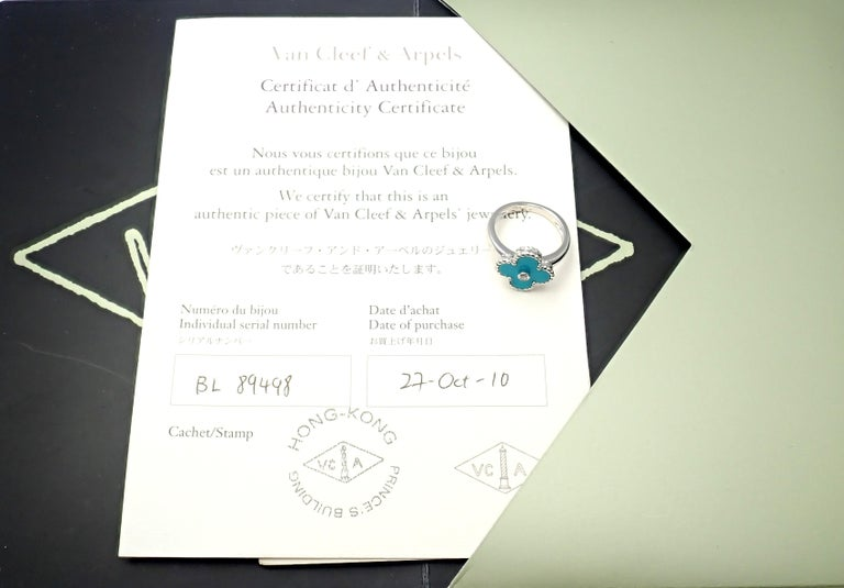 Van Cleef & Arpels Vintage Alhambra 18k White Gold Diamond Turquoise Ring. With 1 Round brilliant cut diamond .06ct F/VS1 Alhambra cut turquoise. This ring comes with certificate of authenticity from Van Cleef & Arpels store. Details: Size: European