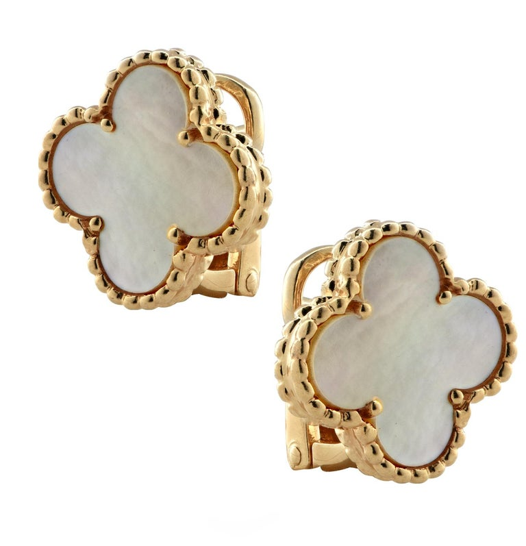 From the legendary House of Van Cleef & Arpels, these iconic Vintage Alhambra earrings, finely crafted by hand in 18 karat yellow gold, with mother-of-pearl inlays, feature an asymmetrical design inspired by the clover leaf. These stunning earrings
