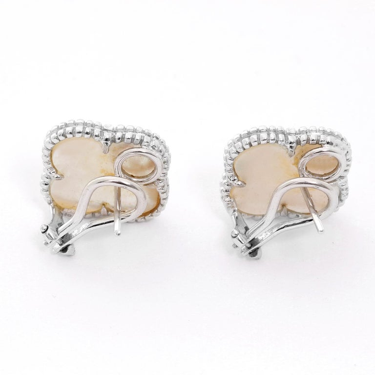 Van Cleef & Arpels Vintage Alhambra Earrings  - White gold Van Cleef & Arpels iconic clover motif. White Mother of Pearl set with round beaded outlines. Total weight 7.7 grams. 18 mm length.