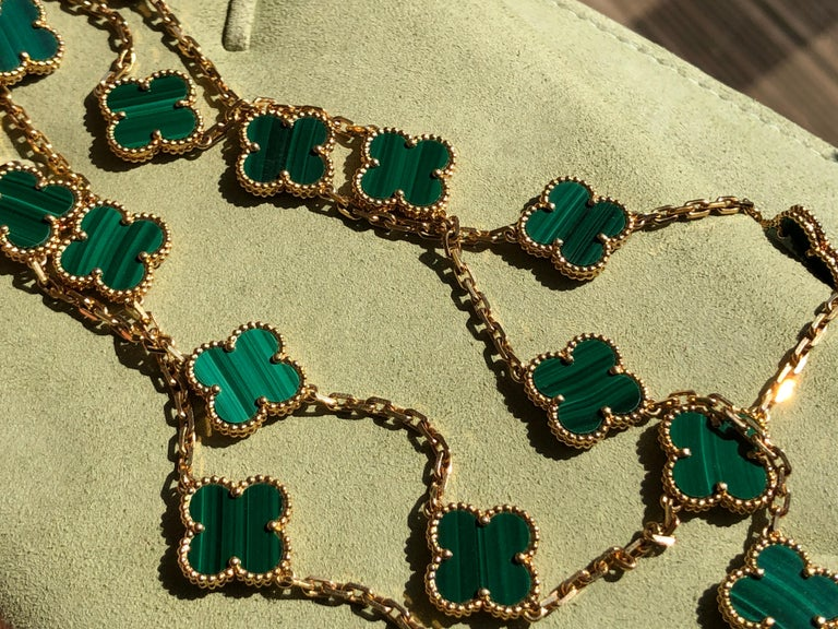 18k Yellow Gold Alhambra 20 Motifs Malachite Necklace by Van Cleef & Arpels was made in 2014. With 20 motifs of Malachite Alhambra stones 15mm each.   This necklace comes with VCA original pouch. Retail Price: £15000  Every piece we sell is 100%