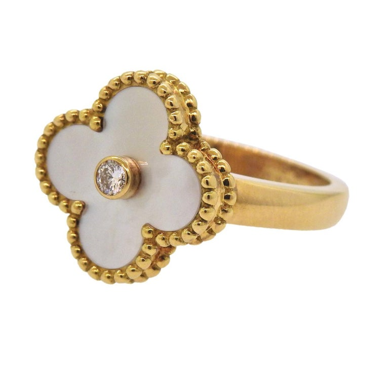 Vintage Alhambra ring, crafted by  Van Cleef & Arpels, set with 0.06ct VVS/FG diamond and mother of pearl top. Ring size - 4.75, ring top - 15mm x 15mm, weighs 6.4 grams. Marked: VCA, G750, 48, JB112***.
