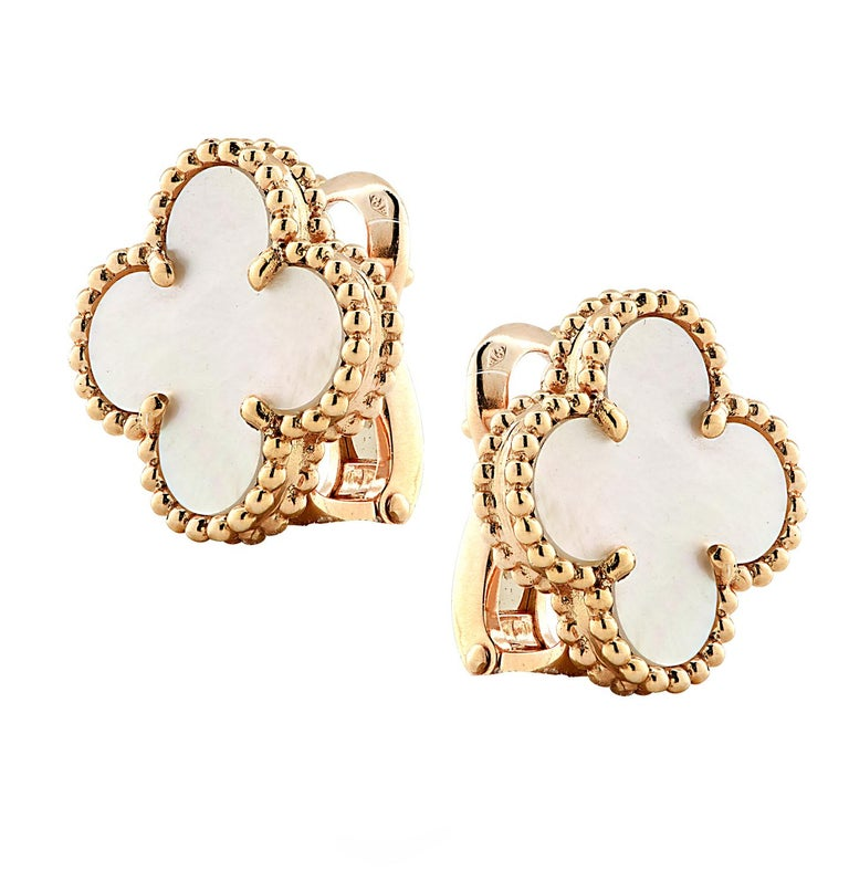 From the House of Van Cleef & Arpels, these exquisite Vintage Alhambra earrings, finely handmade in 18 Karat yellow Gold, feature a symmetrical design inspired by the clover leaf. The clovers are embellished in mother of pearl and are framed in gold