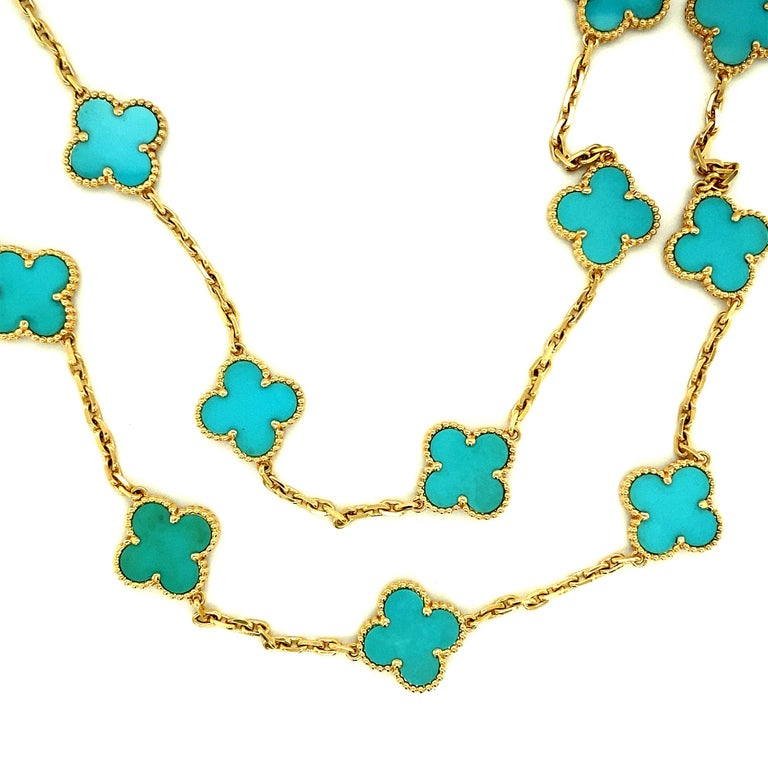 """Van Cleef & Arpels original vintage Alhambra necklace set with 20 turquoise motifs mounted in 18kt Yellow Gold.  The necklace was made in France circa 2012. The necklace is in great condition.  The necklace measures 33 1/2"""" long.  This beautiful"""