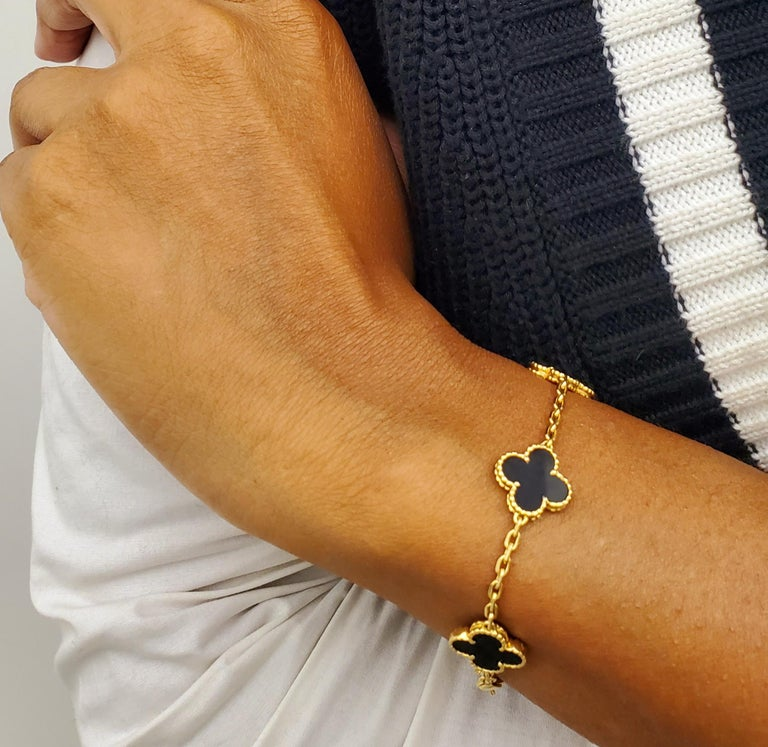 Authentic Van Cleef & Arpels 18 karat yellow gold five motif onyx Alhambra bracelet. Bracelet is marked VCA 750, with serial number and hallmarks.    Stamps are slightly rubbed, but still visibleThe bracelet is 6 3/4 inches in length. Bracelet does