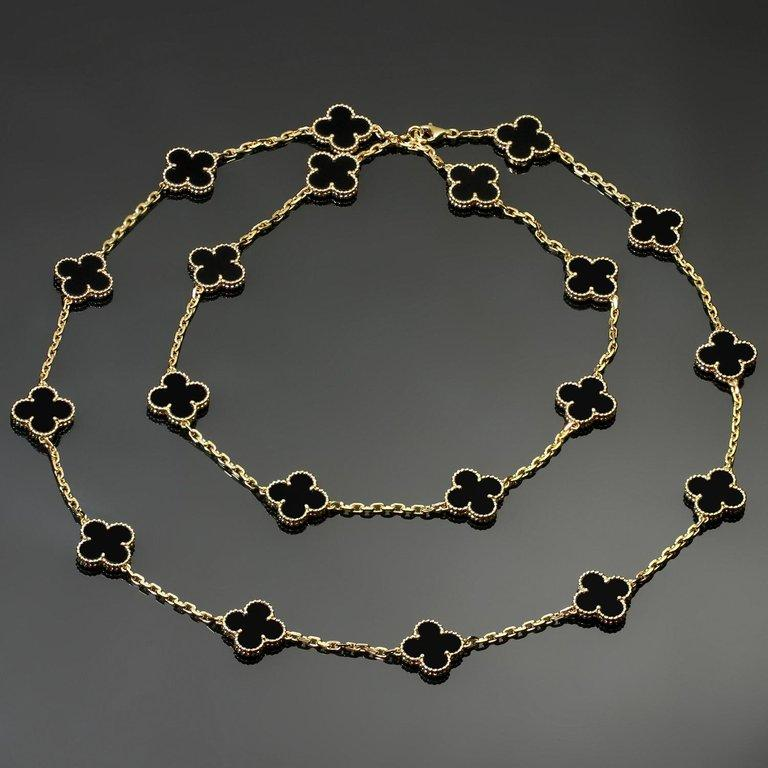 This classic long Van Cleef & Arpels necklace from the iconic Vintage Alhambra collection is crafted in 18k yellow gold and features 20 lucky clover motifs beautifully inlaid with black onyx in round bead settings. Made in France circa 2012.