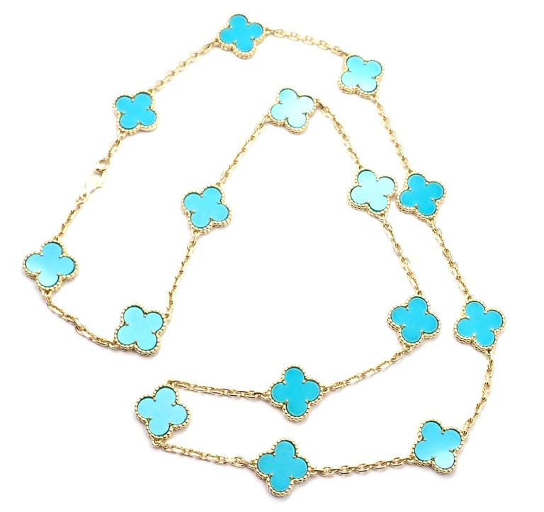 18k Yellow Gold Alhambra 15 Motifs Turquoise Necklace by Van Cleef & Arpels.  This necklace comes with a Van Cleef & Arpels service paper from VCA store and a box. With 15 motifs of turquoise alhambra stones 15mm each Details:  Length: 24.5
