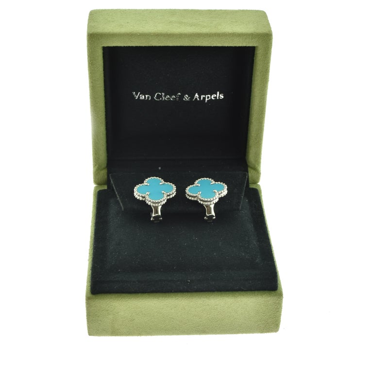 Designer: Van Cleef & Arpels  Collection: Vintage Alhambra  Style: 1 Motif Studs  Stones: Turquoise Onyx   Metal Type: White Gold  Metal Purity: 18k  Total Item Weight (grams): 8.0  Earring Dimensions: 12.87 mm x 14.82 mm  Closure: Omega Post Backs
