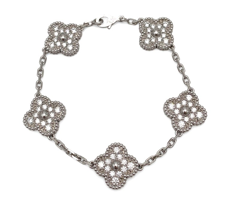 Authentic Van Cleef & Arpels Vintage Alhambra bracelet crafted in 18 karat white gold and set with approximately 60 diamonds, weighing an estimated 1.80 cttw.  The bracelet measures  6.5 inches in length.  Signed VCA, Au750, with serial number and