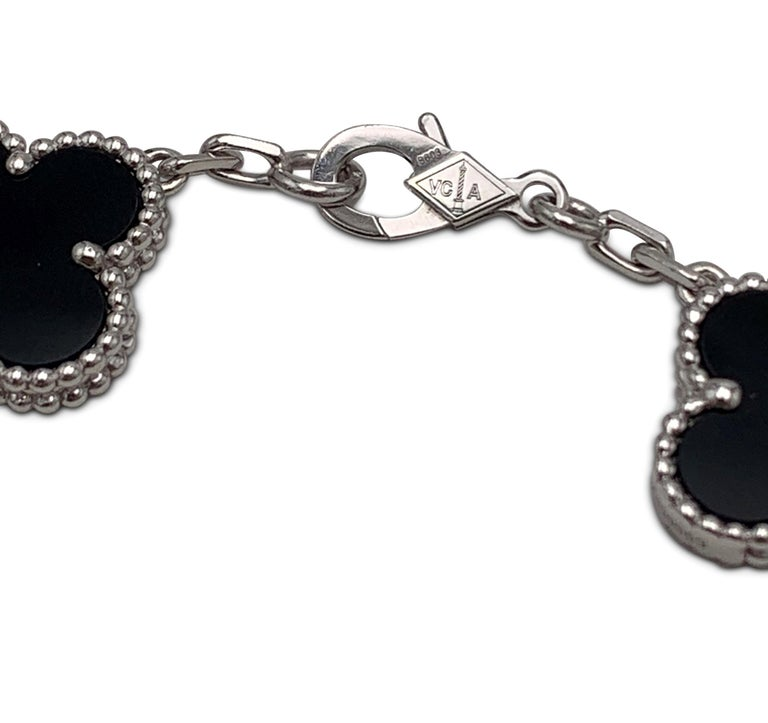 Authentic Van Cleef & Arpels Vintage Alhambra bracelet crafted in 18 karat white gold features alternating clover motifs of onyx and pave diamonds (E-F color, VS clarity) weighing an estimated 0.72 carats total weight.  The bracelet measures 6.5