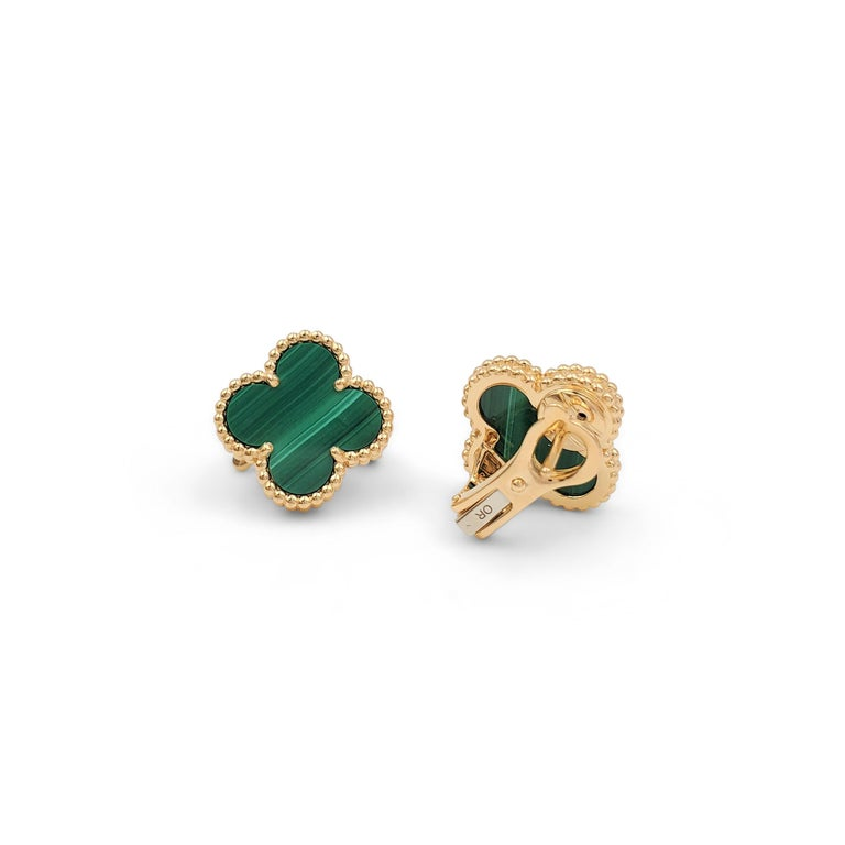 Authentic Van Cleef & Arpels 'Vintage Alhambra' earrings crafted in 18 karat yellow gold featuring the cover leaf-inspired motif in malachite. Signed VCA, Au750, with serial number and hallmarks. The earrings are presented with the original box and