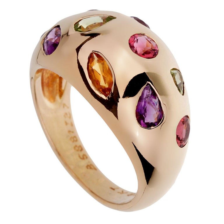 A chic Van Cleef & Arpels ring showcasing multiple gemstones and various shapes in 18k yellow gold.