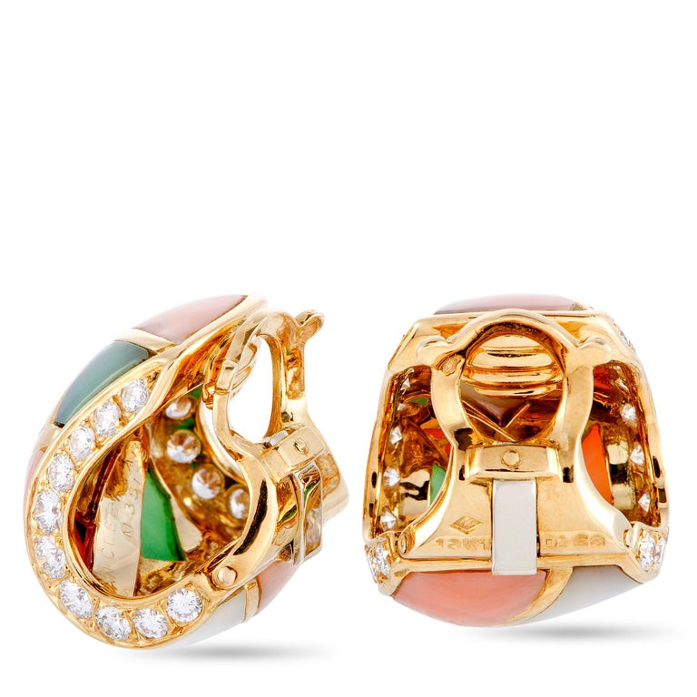 These very rare vintage earrings from Van Cleef & Arpels are crafted from 18K yellow gold and each of the two weighs 12.1 grams. The pair is set with mother of pearl, coral, chrysoprase, and a total of 1.68 carats of diamonds. The earrings measure