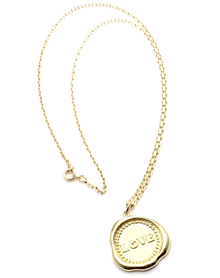 18k Yellow Gold Vintage Love Pendant Necklace by Van Cleef & Arpels.  This necklace comes with Van Cleef & Arpels service paper. Details:  Length: 20