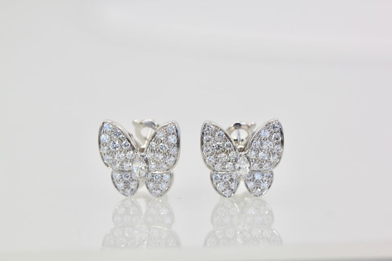 These gorgeous VCA white diamond butterfly earrings are made in 18K white gold and feature 70 Diamonds all clarity IF-VVS, color D,E,F  and weighs in at 1.67 carats and retails for $25,800.  Comes with box and certificate