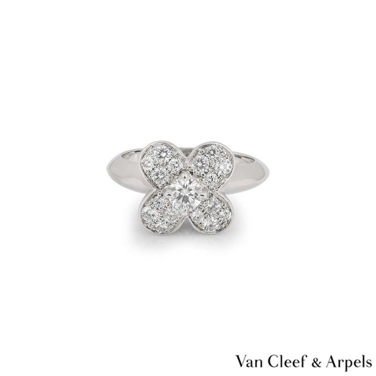 A stunning 18k white gold Alhambra ring by Van Cleef & Arples. The central flower motif is set with a single claw set round brilliant cut diamond weighing approximately 0.35ct. The petals of the flower are pave set with round brilliant cut diamonds