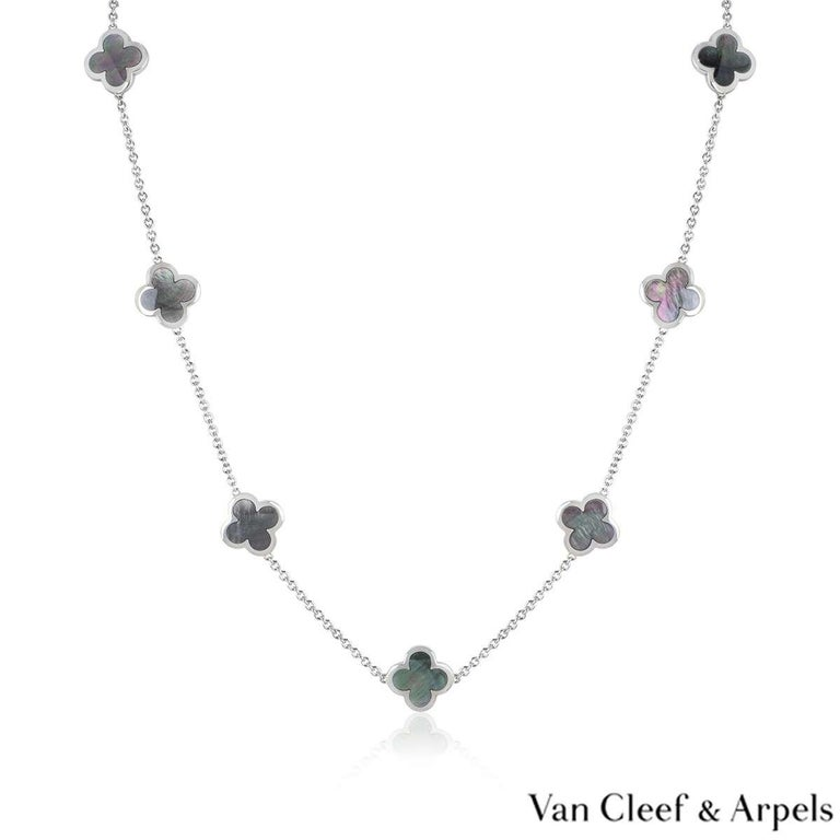 An 18k white gold Pure Alhambra necklace by Van Cleef & Arpels. The necklace is composed of 14 iconic four leaf clover motifs, set to the centre with grey mother of pearl inlays and a polished outer edge. The necklace measures 32 inches in length