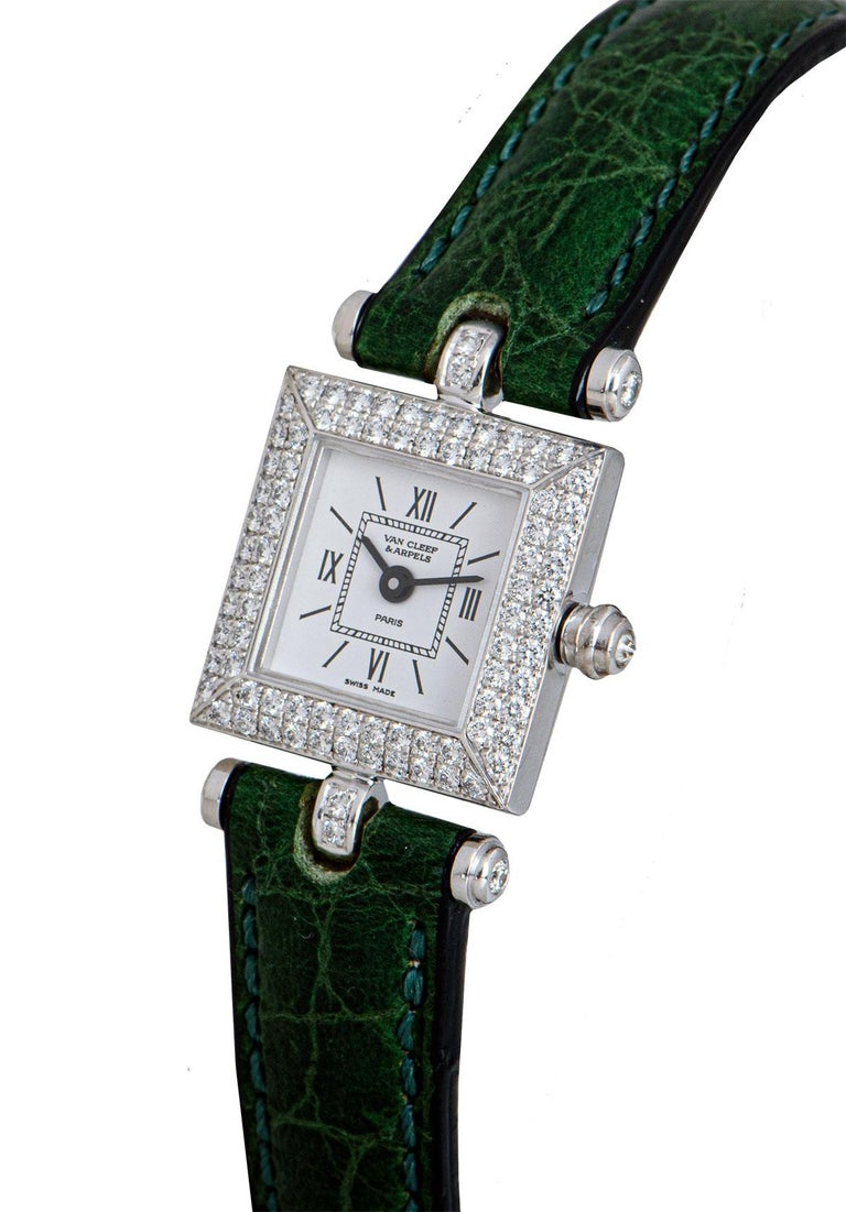 A 17 mm 18k White Gold Ladies Dress Wristwatch, silver dial with hour markers and roman numerals III, VI, IX and XII, a fixed 18k white gold bezel set with approximately 80 round brilliant cut diamonds, an 18k white gold crown set with a single