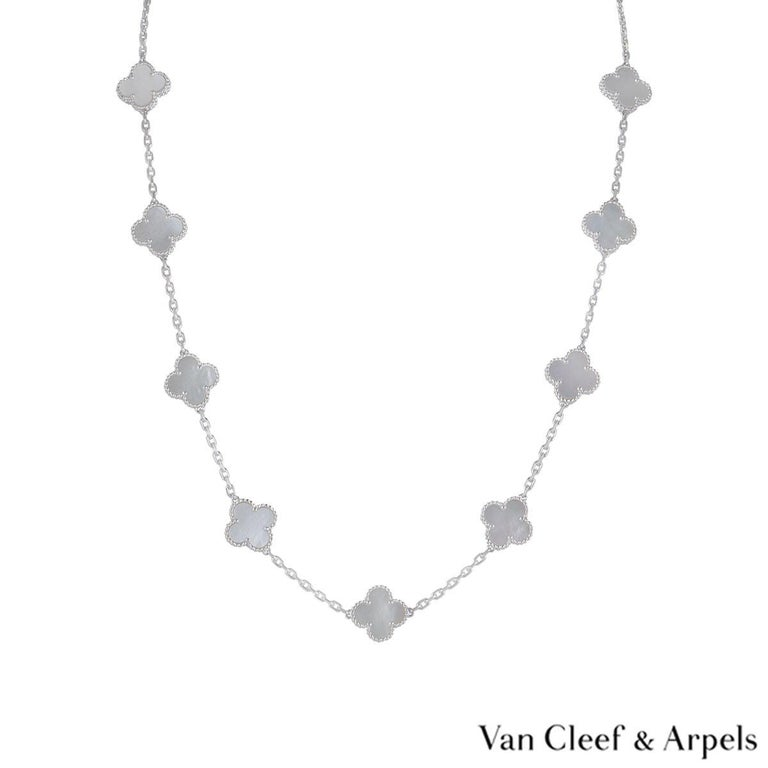 An 18k white gold necklace by Van Cleef & Arpels from the Vintage Alhambra collection. The necklace features 20 iconic 4 leaf clover motifs, each set with a beaded edge and a mother of pearl inlay, set throughout the length of the chain. The trace
