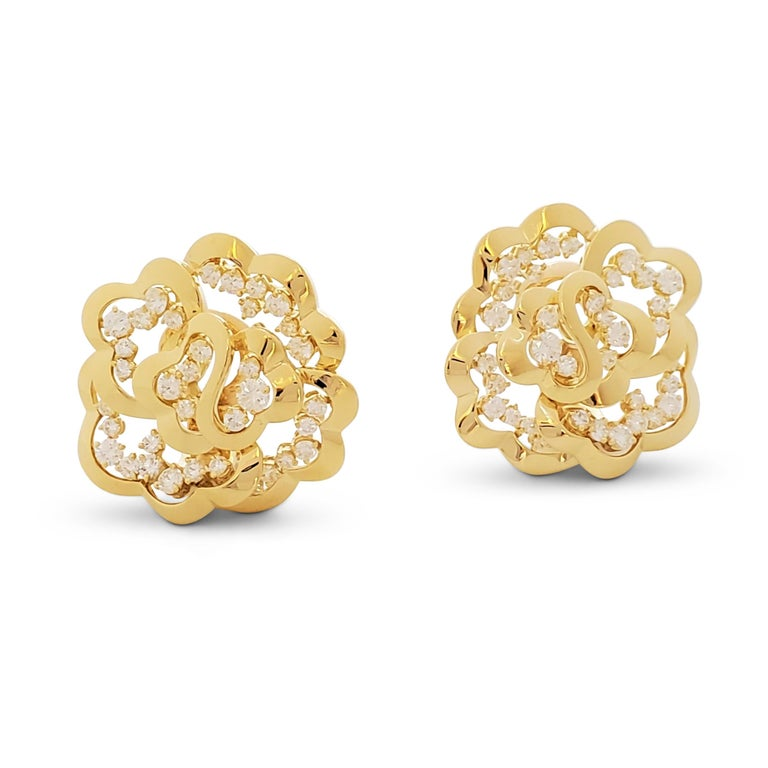 Authentic Van Cleef & Arpels openwork earrings crafted in 18 karat yellow gold and highlighted by an estimated 2.80 carats of round brilliant cut diamonds (E-F color, VS clarity). Signed Van Cleef & Arpels, 750, with serial number. The earrings are