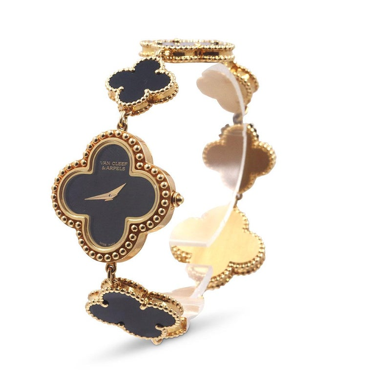 Authentic Van Cleef & Arpels Alhambra watch crafted in 18 karat yellow gold and onyx.  The watch features a clover-shaped carved onyx dial with a 26mm x 26mm case, bezel, and crown of 18 karat yellow gold.  The bracelet features seven carved onyx