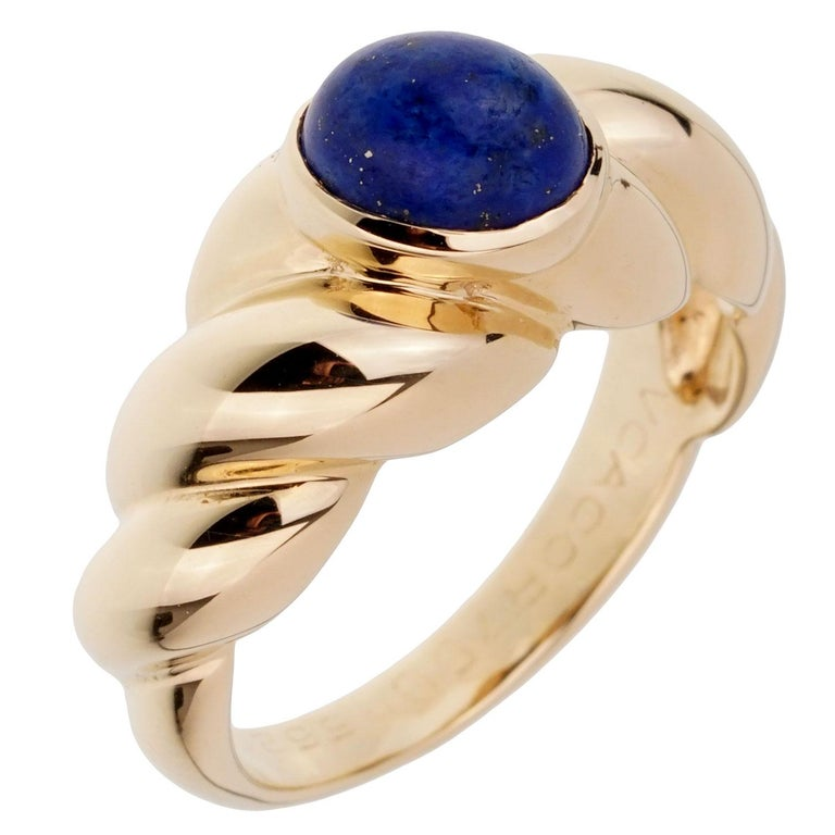A fabulous vintage Van Cleef & Arpels ring set with a cabochon oval Lapis stone in 18k yellow gold. The ring measures a size 6 1/4 and can be resized.
