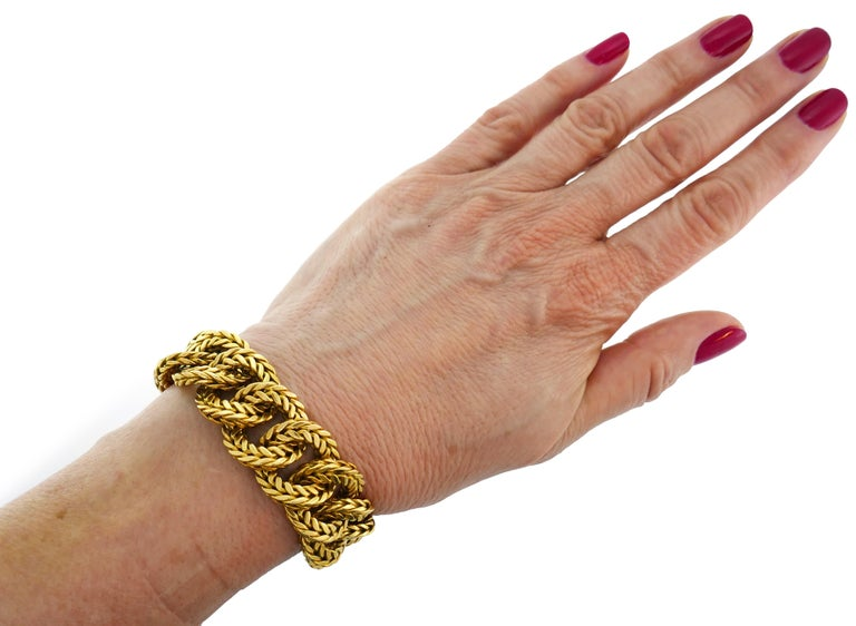 Bold yet elegant bracelet created by Van Cleef & Arpels in France in the 1970s. Timeless and wearable, the bracelet is a great addition to your jewelry collection.  The bracelet is made of 18 karat yellow gold. It measures 7 inches x 3/4 inches