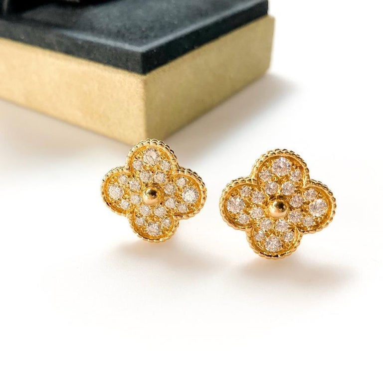 Luxury and the beauty of nature meet with this stunning Van Cleef & Arpels 18k Gold and Diamonds Magic Alhambra Earrings. This emblematic and celebrated clover shaped earrings have been a favorite among fans and is made of gorgeous 18k yellow gold
