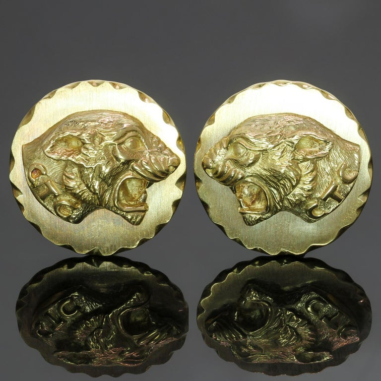These vintage Van Cleef & Arpels round cufflinks feature a stunning motif of fierce panthers crafted in 18k yellow brushed and polished gold. Made in France circa 1970s. Measurements: 0.78