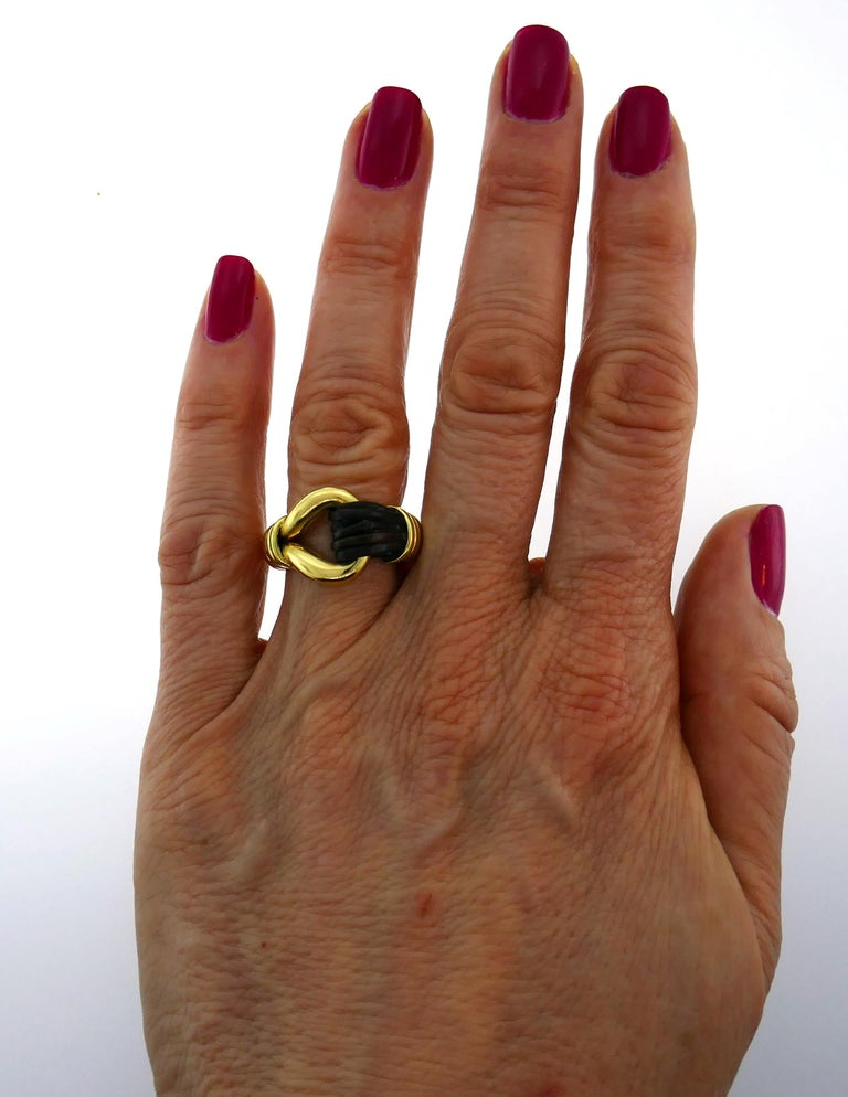 Elegant and understated cocktail ring created by Van Cleef & Arpels in the 1970s.  Made of 18k yellow gold. Size 6.  Top part of the ring measures 3/4 x 1/2 inch (1.8 x 1.4 cm). Weight 13.3 grams. Stamped with Van Cleef & Arpels maker's mark, a