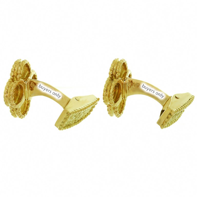 These iconic cufflinks from Van Cleef & Arpels's Vintage Alhambra collection are made in 18k textured yellow gold and feature the classic festive design inspired by the symbol of luck. Made in France circa 1990s. Measurements: 0.59