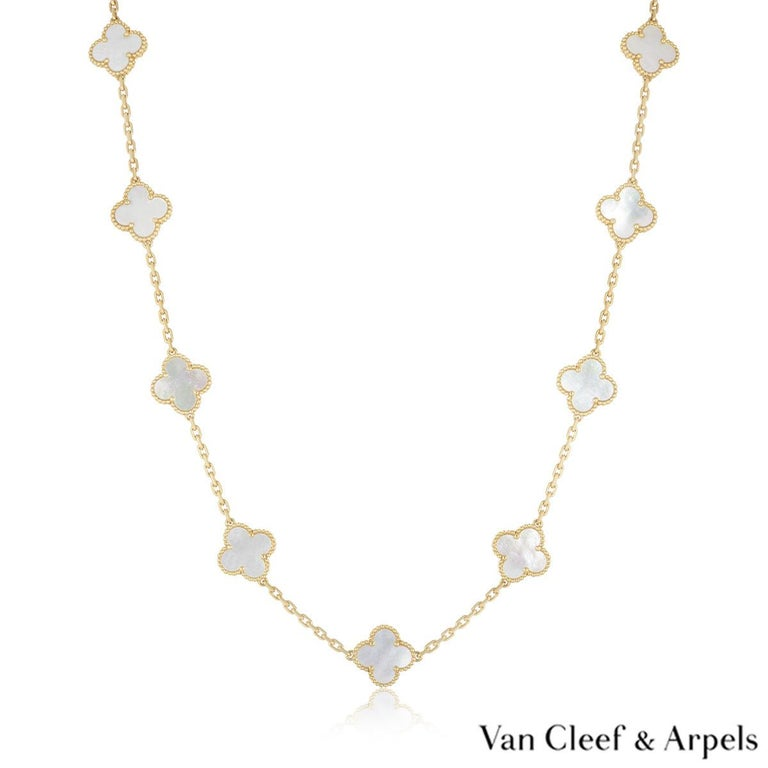 An 18k yellow gold necklace from the Vintage Alhambra collection by Van Cleef & Arpels. The necklace features 20 iconic 4 leaf clover motifs, each set with a beaded edge and a mother of pearl inlay, set throughout the length of the chain. The trace