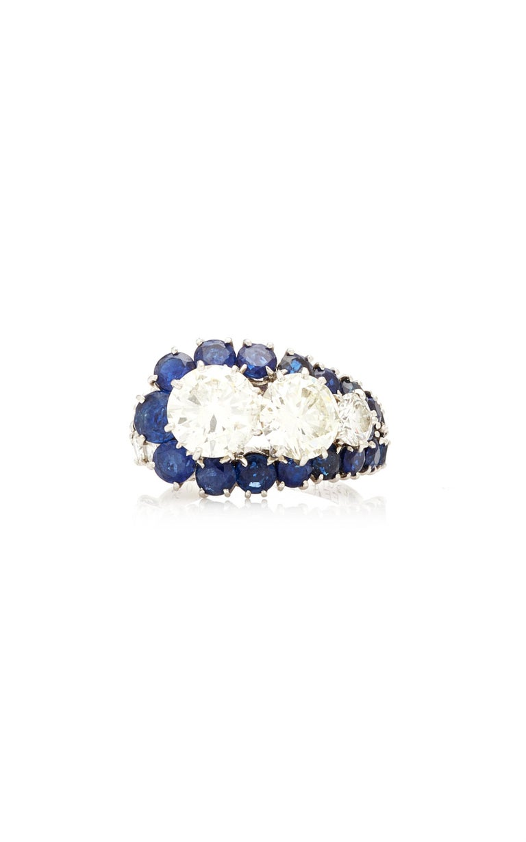 Van Cleef & Arpels ring in white gold with 3 diamonds (respectively 0.5, 1.5, and 2 cts) and sapphires. Made in France, circa 1950