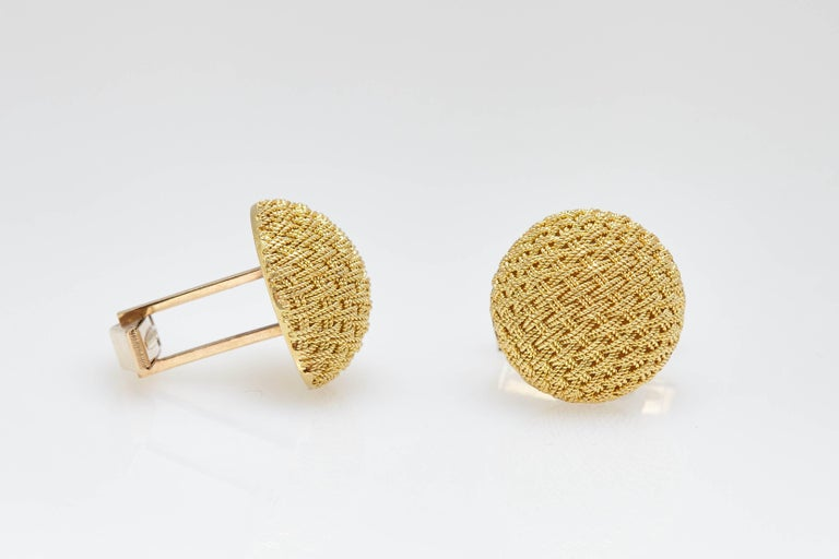 A pair of Van Cleef New York textured 14kt gold cufflinks. Made in the U.S, circa 1960s.