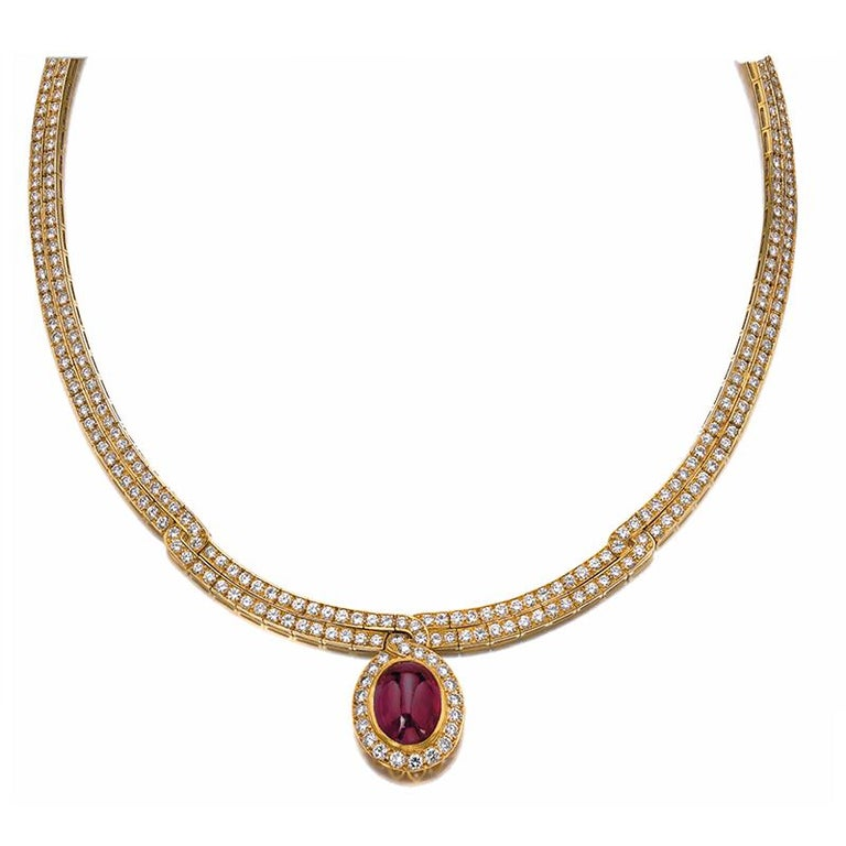 A Ruby and Diamond Necklace by VAN CLEEF & ARPELS set throughout with brilliant-cut diamonds, the front accented with a cabochon ruby, signed Van Cleef & Arpels, numbered, French assay mark for gold and maker's mark. The ruby weighs approximately 14