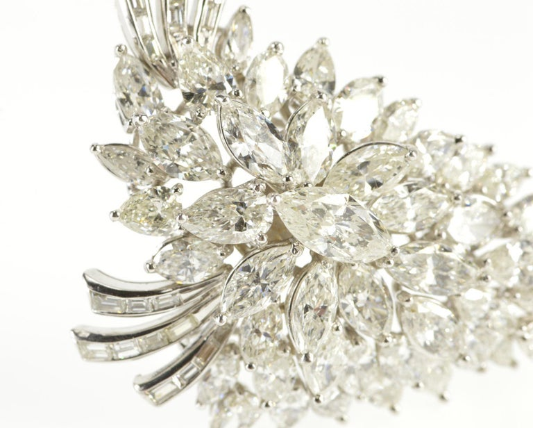 A Grand Marquise of diamonds, this tantalizing piece by Elwood Van Clief doubles as both a pendant and a brooch. Featuring an exquisite combination of marquise diamonds, the piece contains 25x .20 carat marquise diamonds totaling 5 carats, 15x .25