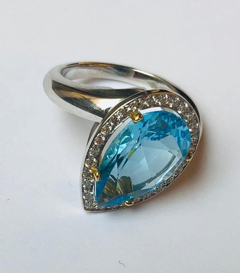 This beautifully crafted ring features a large Blue Topaz set in white gold 18 kt. and is surrounded by diamonds.  This ring was designed and made by Van der Veken, an Antwerp, Belgium-based High Jewelry house founded in 1952. Each jewel is unique,